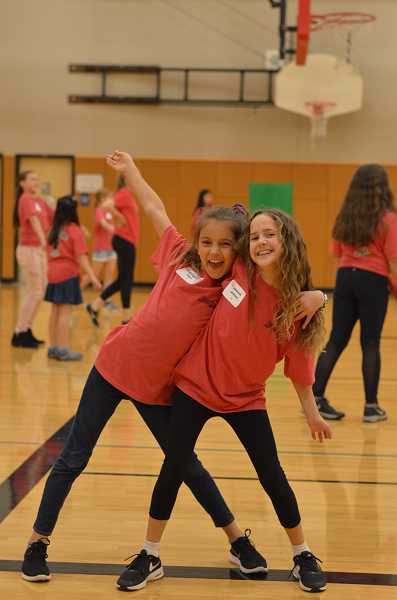 TIDINGS PHOTO: CLARA HOWELL - Sixth-grade friends Ashlynn Atack (left) and Savannah Johnson (right) get ready to play a game in the gym at Turning Point.
