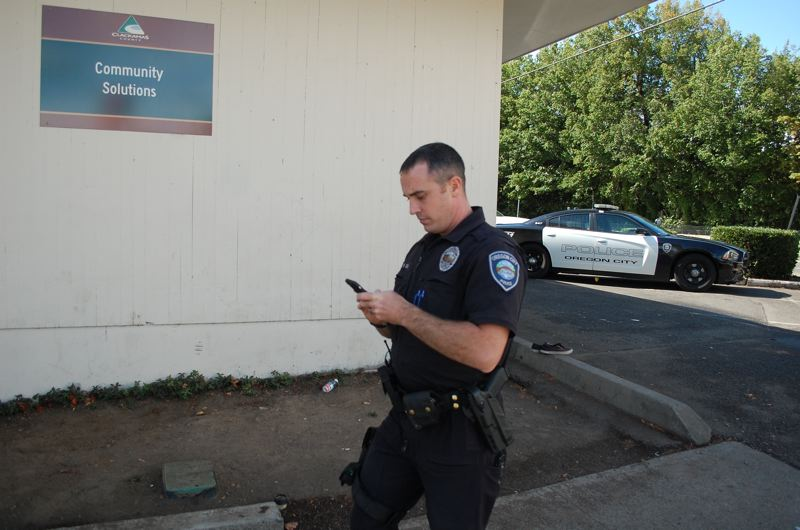 PHOTO BY: RAYMOND RENDLEMAN - Officer Mike Day outside of the Clackamas County Community Solutions office in Oregon City's downtown.