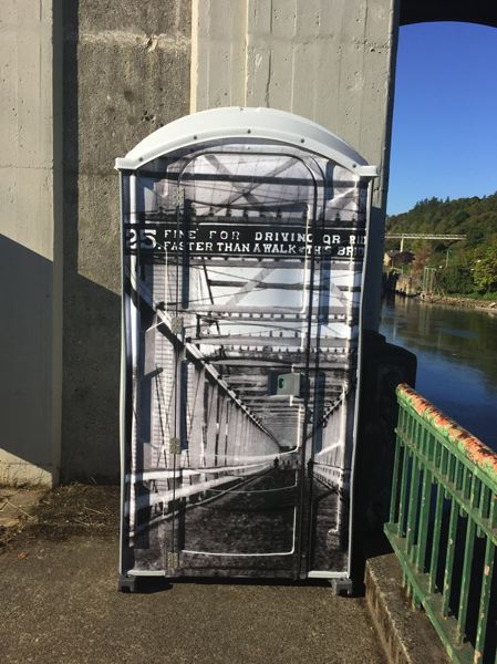 PHOTO BY: RAYMOND RENDLEMAN - A 24-hour toilet next to the Arch Bridge includes an 1895 historic photo of the span between Oregon City and West Linn.