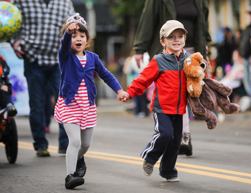 OUTLOOK PHOTO: JOSH KULLA - Excited children race down Main Avenue Saturday during the Gresham Soroptimist Teddy Bear Parade.