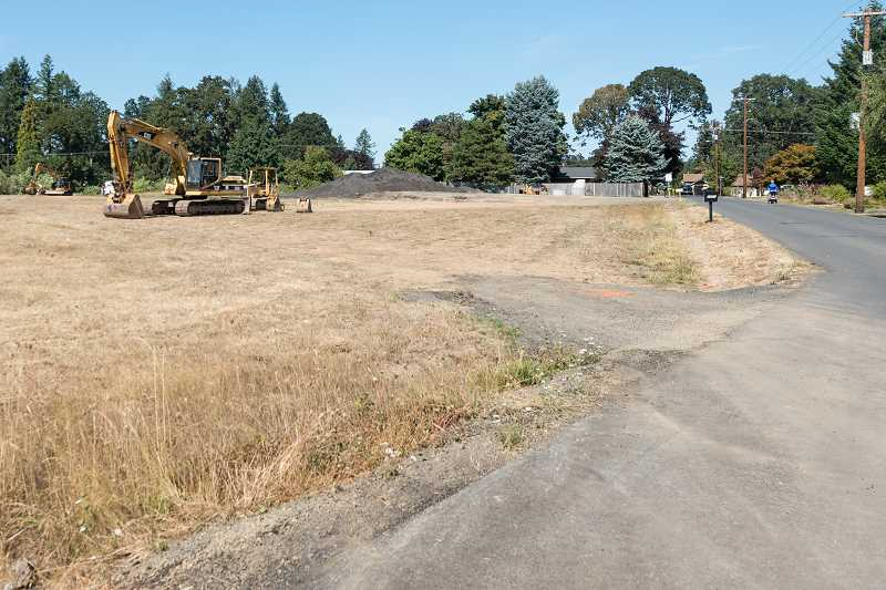 NEWS-TIMES PHOTO: CHRISTOPHER OERTELL - This cleared lot at Hawthorne Street and 26th Avenue in Forest Grove will ultimately hold 29 single-family homes and an apartment building.