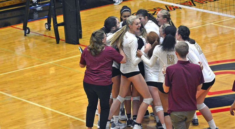TIMES PHOTO: MATT SINGLEDECKER - The Southridge volleyball team celebrates its fifth set triumph over Jesuit to take a three-game lead in Metro.