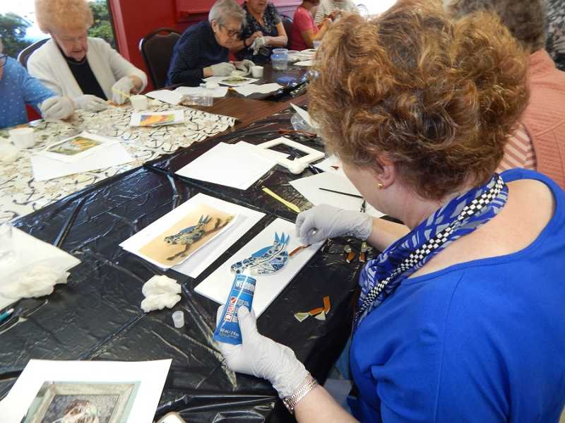 BARBARA SHERMAN - Summerfield Craft Club member Susan Burson, right, creates a blue bird out of china chips using a kit made by instructor Lydia Cooper that included a photo of the finished product and china chips the right color and size for the design.