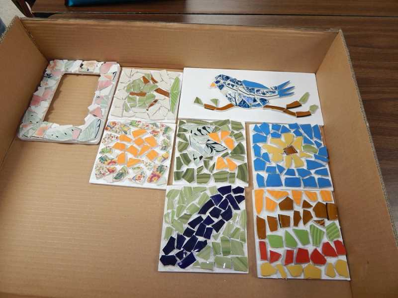 BARBARA SHERMAN - Some of the finished products made by members of the Summerfield Craft Club were placed in a box for instructor Lydia Cooper to take home before grout was later added between the pieces.