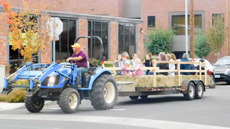 ESTACADA NEWS PHOTO: EMILY LINDSTRAND - Hay rides took participants through downtown Estacada during the Harvest Festival on Saturday, Sept. 30.