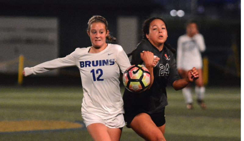 OUTLOOK PHOTO: DAVID BALL - Barlows Paige Hinkel chases down a high bouncer alongside Clackamas Kori Walters during the second half of the Bruins' 5-4 win Tuesday night.