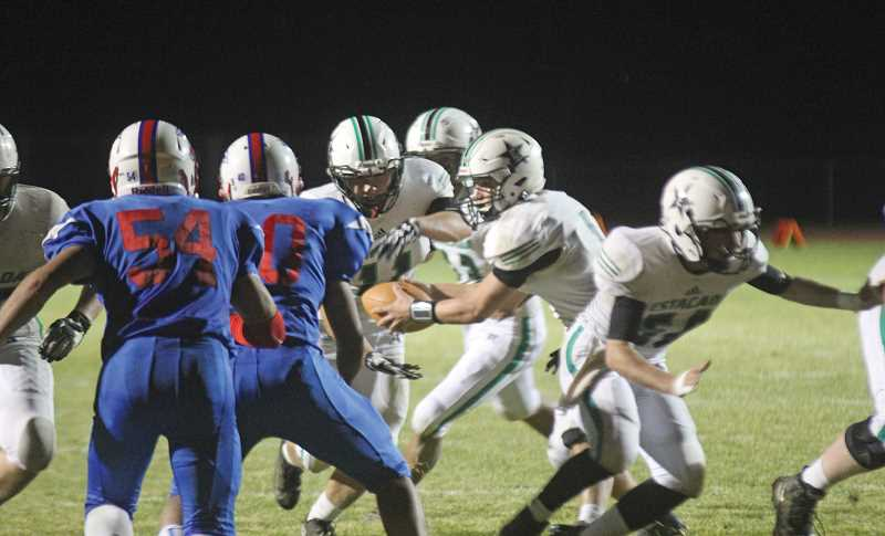 WILL DENNER/MADRAS PIONEER - Estacada's well-executed option offense fooled Madras on several occasions last Friday, yielding 298 rushing yards.