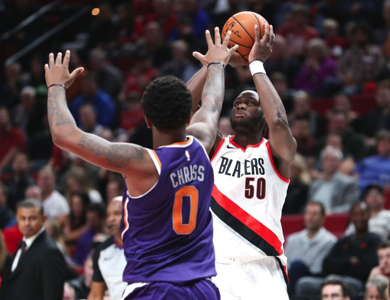 TRIBUNE PHOTO: JAIME VALDEZ - Caleb Swanigan, new power forward for the Trail Blazers, shoots over Marquese Chriss of the Phoenix Suns.