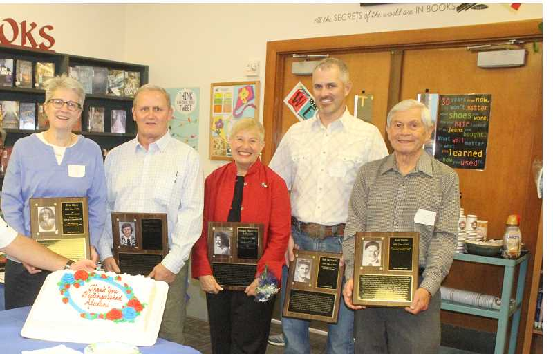 SUSAN MATHENY/MADRAS PIONEER - MHS faculty held a reception in the school library for the distinguished alumni, who included, from left, Erin Olson, Dallas Stovall, Margie (McBride) Lehrman, Tom Norton Jr., representing his dad Tom Norton Sr., and Ken Smith.