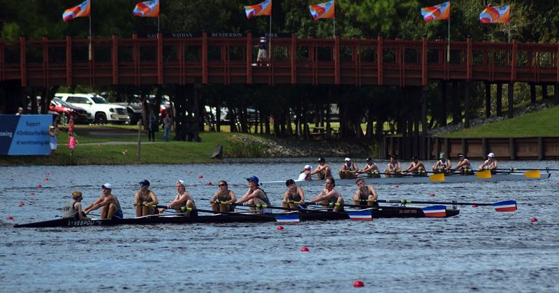 SUBMITTED PHOTO - Aiden Susak (blue baseball cap), Will La Fond (white backwards cap) and Adrian Edwards (second from right) race to the finish in one of two Northwest mens eights in the Youth Regional Challenge that was part of the 2017 FISA World Rowing Championships in Sarasota, Florida in late September.