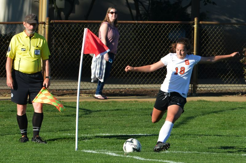 SPOTLIGHT PHOTO: JAKE MCNEAL - Indians freshman midfielder Grace Negelspach (18) launches a corner kick.