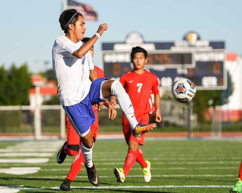 OUTLOOK PHOTO: JOSH KULLA - Gresham junior Diego Romero makes a play on the ball Tuesday during the Gophers' 0-0 draw in Mount Hood Conference boys prep soccer.