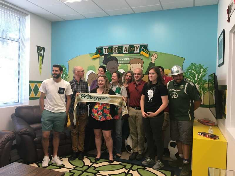 COURTESY PHOTO - Portland Timbers star Diego Valeri (left), Timber Joey and Timbers Army members decorated a family visitation room in the Hillsboro Child Welfare office last year and the Beaverton office this past July in order to make the spaces more comforting to children.