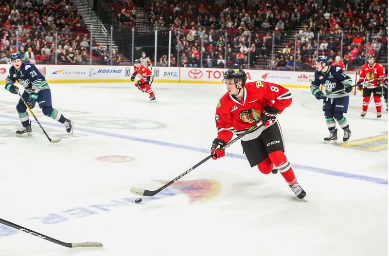 COURTESY: DAYNA FJORD/PORTLAND WINTERHAWKS - Cody Glass brings the puck up the ice for the Portland Winterhawks during the home opener last week against the Seattle Thunderbirds.