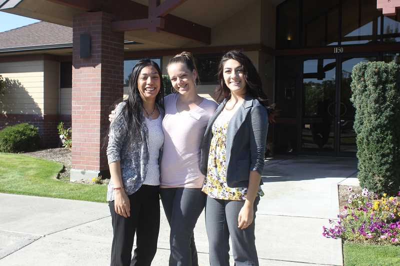 SUSAN MATHENY/MADRAS PIONEER - First Interstate Madras Branch Manager Kim Pilkington, center, poses with tellers Giovanna Valasquez, left, and Keturah Rico, right, in front of the bank.