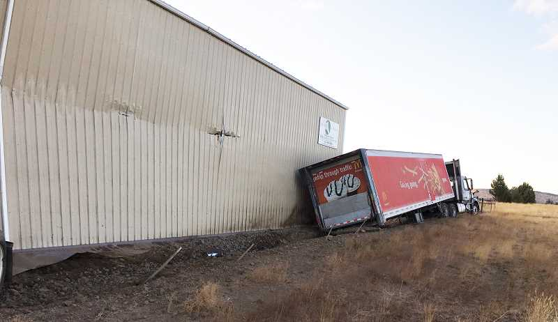 JEFFERSON COUNTY SHERIFF'S OFFICE PHOTO - The frozen foods truck struck the length of the hay barn.