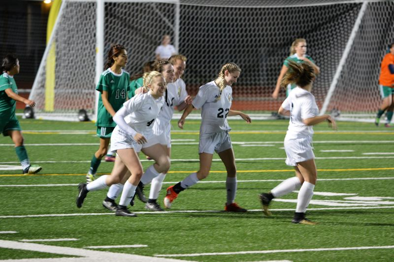 SPOTLIGHT PHOTO: JAKE MCNEAL - Senior midfielder Myranda Northrop (4), senior defender Sarah Bjork (22) and the Lions will set out to upset No. 7 Milwaukie on Thursday.