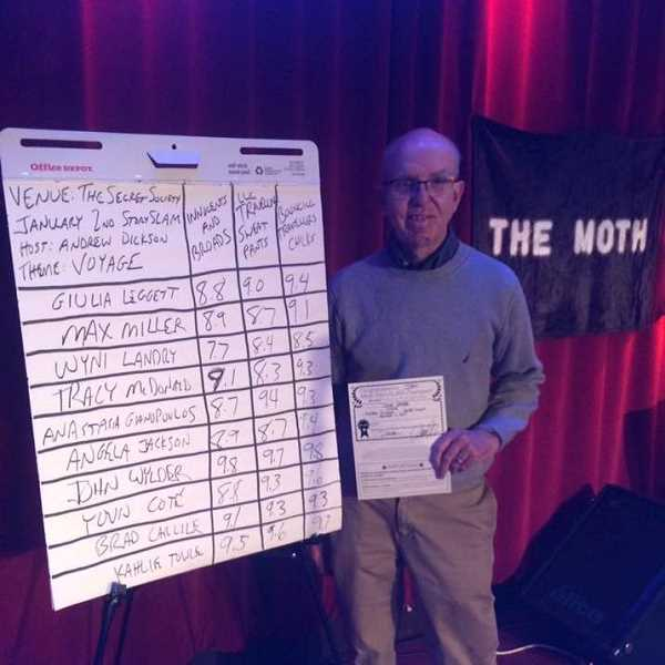 SUBMITTED PHOTOS  - John Wylder stands by the scoreboard at The Moth storytelling competition. He has competed and won several of the competitions and will share his stories Saturday at Clinton Street Theater. You can also see him compete in a Grand Slam Moth reading Oct. 24.