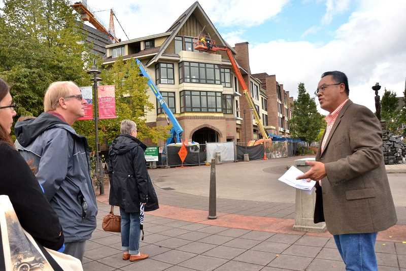 REVIEW PHOTO: VERN UYETAKE - Lake Oswego Development Project Manager Sidaro Sin (right) leads visitors from the Oregon League of Cities on a tour of the downtown Urban Renewal Area last week. The Windward (pictured in the background) was the main focus of the tour, but there were also previews of the North Anchor project and a mixed-use building at B Avenue and Third Street.