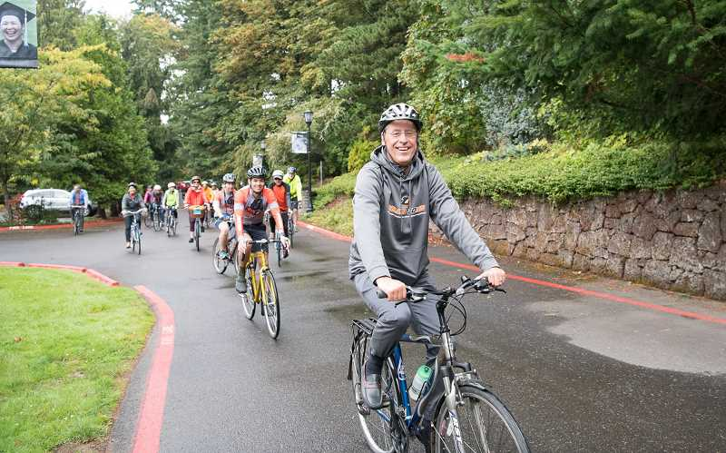 SUBMITTED PHOTO - Wim Wiewel kicks off his first day as president of Lewis & Clark College on Monday with a ceremonial bike ride, accompanied by faculty, students and staff from the private liberal arts school.