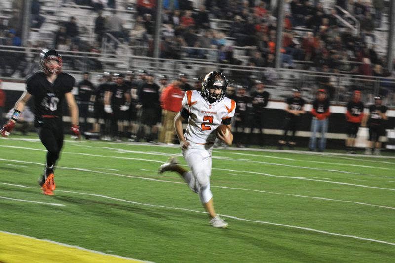 SPOTLIGHT PHOTO: JAKE MCNEAL - Indians senior quarterback Jerad Toman (2) runs to the left pylon for a five-yard touchdown.
