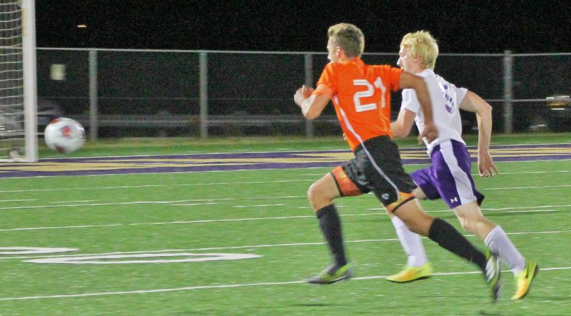 PHOTO CREDIT: JUDY REED - Indians senior Austin Schwalge (21) races to a loose ball.