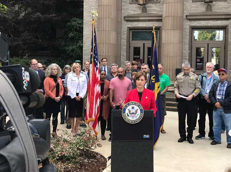 HILLSBORO TRIBUNE PHOTO: GEOFF PURSINGER - Congresswoman Suzanne Bonamici speaks with reporters during a press conference outside the Washington County Circuit Court last week. Bonamici has called for an investigation after ICE questioned a legal American citizen outside the courthouse.
