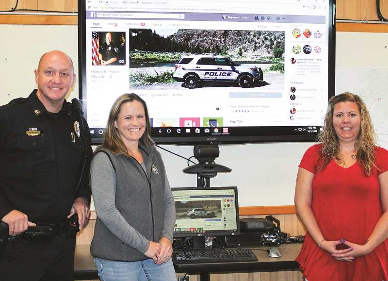 JASON CHANEY - The Prineville Police Department made extensive use of its social media reach during the week of the eclipse. Captain Larry Seymour (left), Evidence Technician Mandi Noland (center) and Office Technician Stephanie Uppendahl teamed up to provide up-to-the-minute information on traffic jams, vehicle accidents and other important information for residents and visitors.