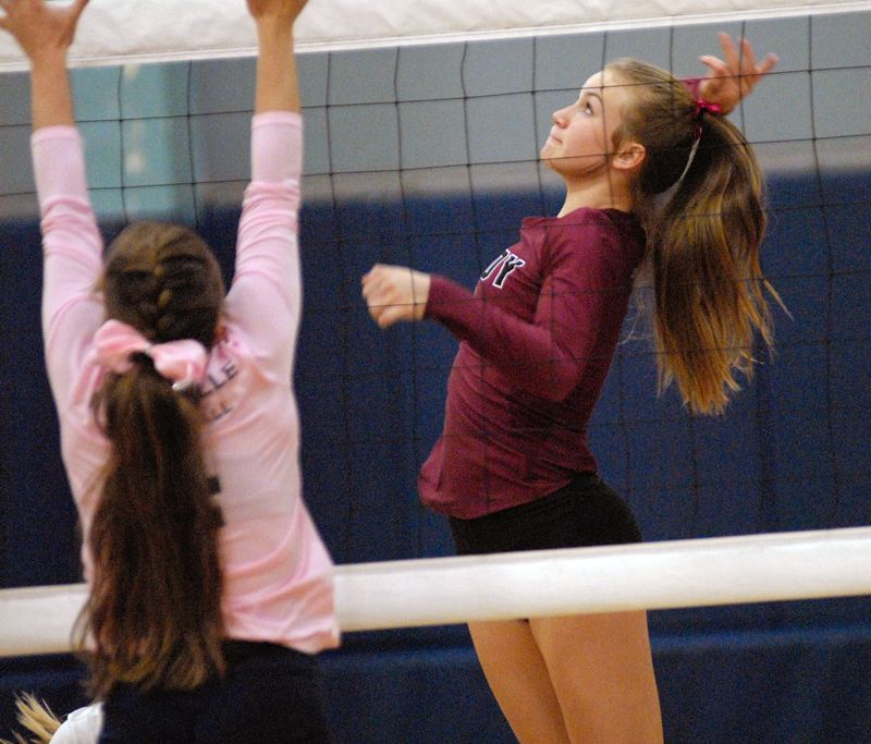 SANDY POST: MATT RAWLINGS - Sandy's Olivia Caldwell goes up for the spike against Wilsonville.
