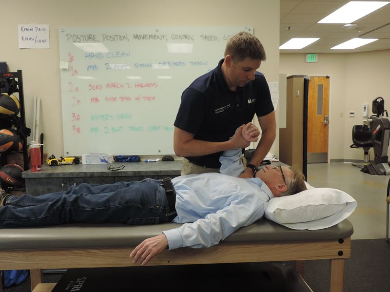 COURTESY: LEGACY HEALTH - Tom Lyttle working with Brett Schafman who has a rotator cuff complaint.