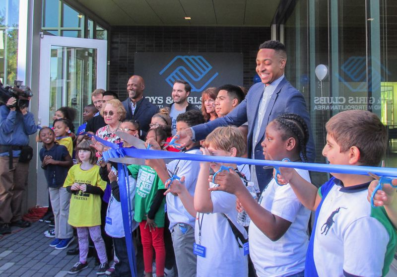 OUTLOOK PHOTO: TERESA CARSON - Donors, dignitaries and a gaggle of children cut a blue ribbon to open the new Rockwood Boys & Girls Club at 165th Avenue and Stark Street.