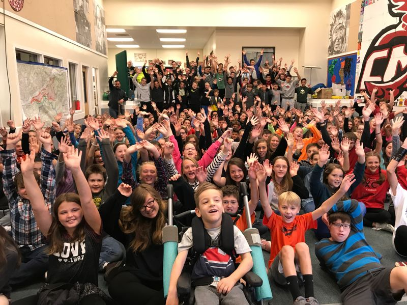 CONTRIBUTED PHOTO: SPARROW CLUBS - Taran, a medically-fragile Portland boy, is surrounded by students from the Corbett School District, who will sponsor him through a newly formed Sparrow Club.