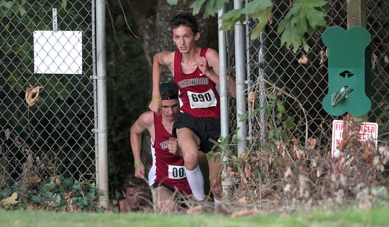 PAMPLIN MEDIA GROUP: MILES VANCE - Sherwood's Jaron Homer emerges from the forest during last week's meet at Lake Oswego Junior High.