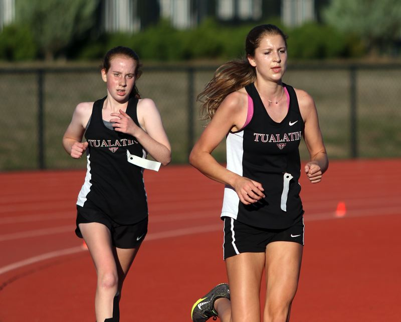 DAN BROOD - Tualatin senior Madi Lowry (right) and freshman Averi Lewis stride out during last week's meet at Newberg.
