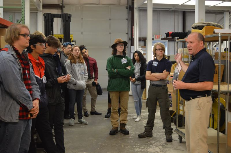 SPOTLIGHT PHOTO: COURTNEY VAUGHN - Tony Erickson, far right, leads students from Benson Polytechnical High School in Portland on a tour of the Oregon Aero headquarters in Scappoose. The students visited during Manufacturing Day, which gives students a chance to tour and explore manufacturing sites around the region