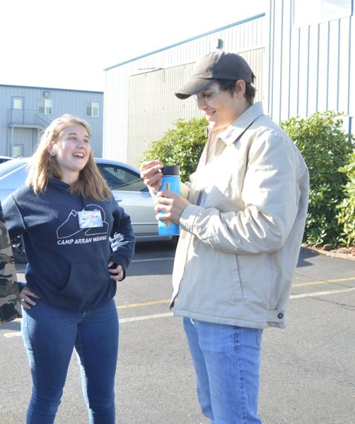 SPOTLIGHT PHOTO: COURTNEY VAUGHN - Sara Jones, left, chats with Eddie Peabody during a tour of Oregon Aero Friday, Oct. 6. Jones and Peabody are students at Benson Polytechnic High School in Portland and toured the facility for Manufacturing Day.