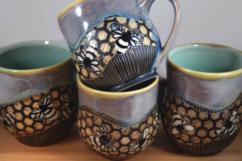 COURTESY - Ceramics by Carolyn Bulkley, like these mugs, will be among the art pieces featured at Art in the Burbs.