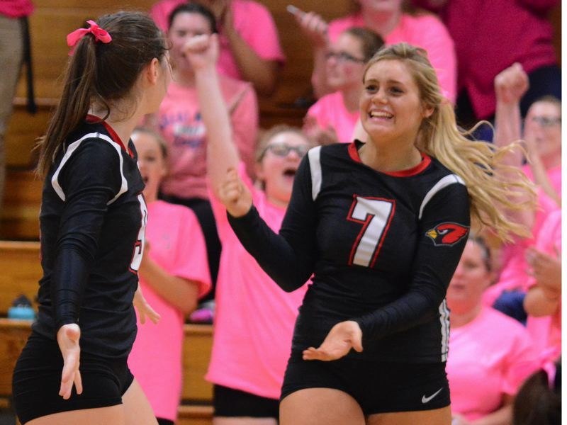 OUTLOOK PHOTO: DAVID BALL - Corbetts Abigail Fritz celebrates after watching an Estacada attack go wide on match point last Thursday.