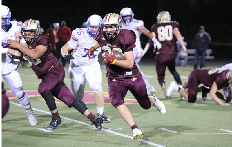 REVIEW/NEWS PHOTO: JIM BESEDA - Milwaukie's Chazz Amundson finished with a game-high 220 yards rushing on 27 carries, helping lead the Mustangs' to a 36-34 Northwest Oregon Conference home win over La Salle Prep Friday.
