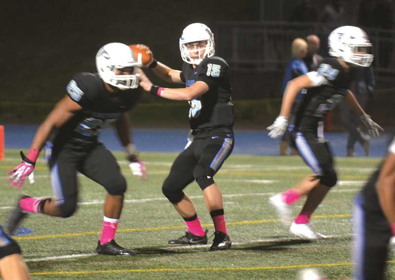 HERALD PHOTO: TANNER RUSS - Pacer quarterback Curtis Maynes scored several touchdowns against the Canby defense on Friday, Oct. 6. Lakeridge defeated Canby 46-14.