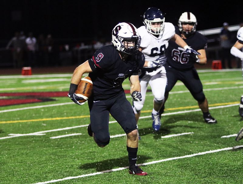 DAN BROOD - Sherwood senior Zach Jenkins heads up field during the Bowmen's game with Lake Oswego.