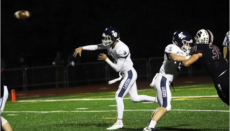 DAN BROOD - Lake Oswego senior quarterback Jake Dukart threw for 292 yards and a pair of touchdowns in the Lakers' 27-16 win at Sherwood.