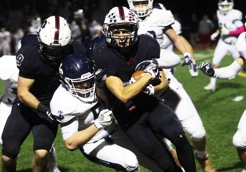 DAN BROOD - Sherwood junior Jacob Reuter powers his way for more yardage in Friday's game.