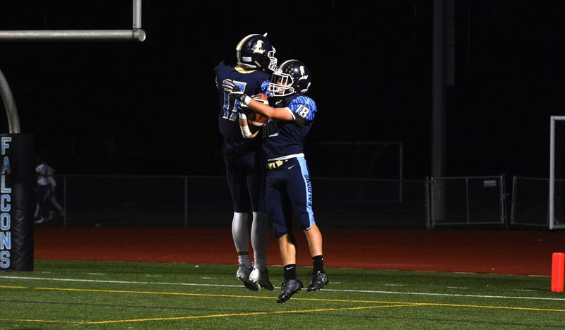 TIMES PHOTO: MATT SINGLEDECKER - LIberty juniors Sam Romeo and Aidan Maloney celebrate a Romeo touchdown against Westview.