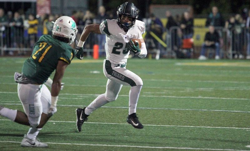 PAMPLIN MEDIA GROUP PHOTO: MILES VANCE - Tigard's Braden Lenzy was seemingly everywhere on Friday night, leading his team in total offense and also making a key interception in his team's 9-0 win at West Linn High School.