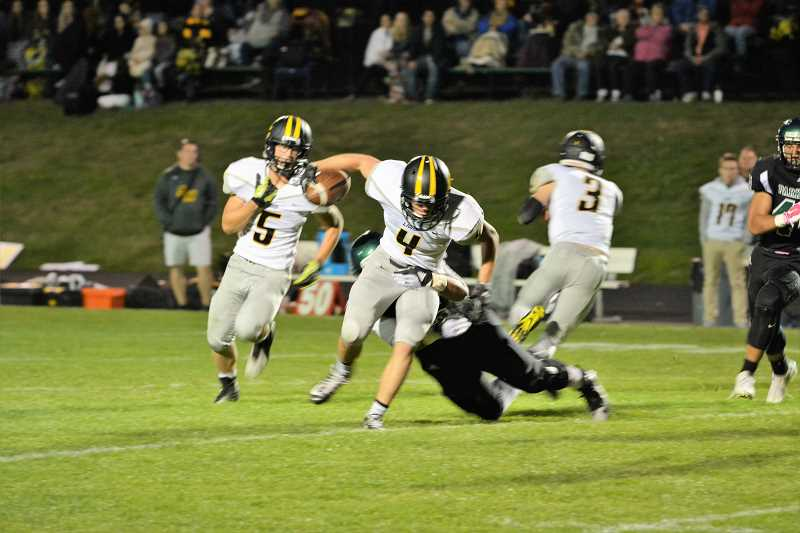SPOTLIGHT PHOTO: JAKE MCNEAL - Lions senior wide receiver Dylan Kessinger (4) breaks a tackle.