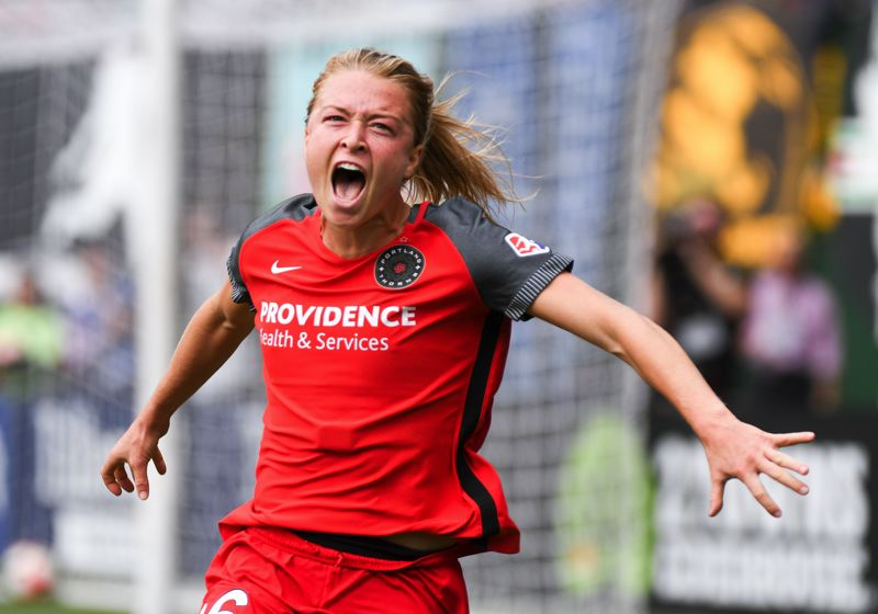 TRIBUNE PHOTO: JOSH KULLA - Emily Sonnett scores for the Portland Thorns as they defeat the Orlando Pride, 4-1.