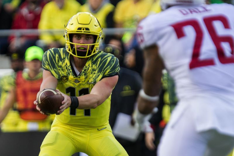 TRIBUNE PHOTO: DAVID BLAIR - Oregon quarterback Braxton Burmeister runs a play against Washington State.