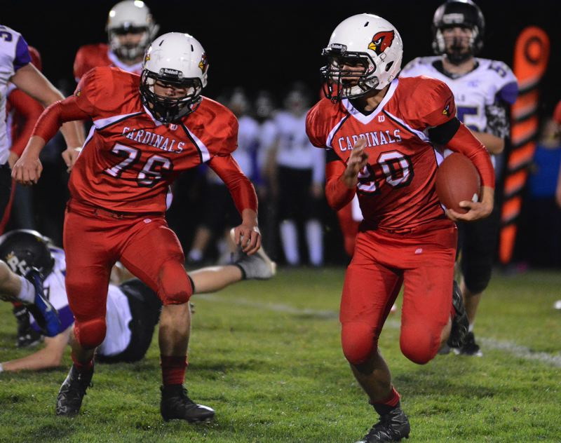 OUTLOOK PHOTO: DAVID BALL - Corbett running back Austin Arnold takes off on one of his two long third-quarter TD runs, scores that lifted the Cardinals to a 48-18 home win over Portland Christian on Friday.