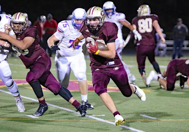 REVIEW/NEWS PHOTO: JIM BESEDA - Milwaukie's Chazz Amundsen breaks free for some of his 220 yards during his team's 36-34 home win over La Salle.